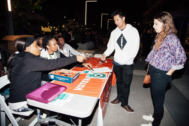Young people registering to vote at a concert