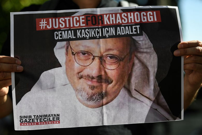 Friends of murdered Saudi journalist Jamal Khashoggi hold posters bearing his picture as they attend an event marking the second-year anniversary of his assassination in front of Saudi Arabia Istanbul Consulate, on October 2, 2020. - Khashoggi, a Washington Post columnist, was killed and dismembered at the Saudi consulate in Istanbul on October 2, 2018, in an operation that reportedly involved 15 agents sent from Riyadh. His remains have not been found. (Photo by Ozan KOSE / AFP) (Photo by OZAN KOSE/AFP via Getty Images)
