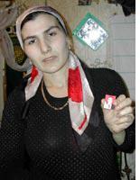 Imani Soltukhanova holds a photo of her husband, slain human rights activist Aslan Davletukaev