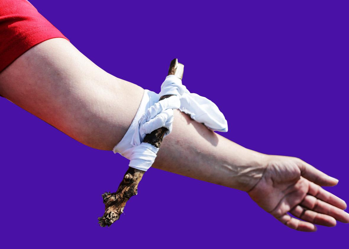 A volunteer poses with a tourniquet on his arm in Bordeaux, western France, on July 30, 2016, during a Red Cross workshop on first aid after the different attacks that struck France.