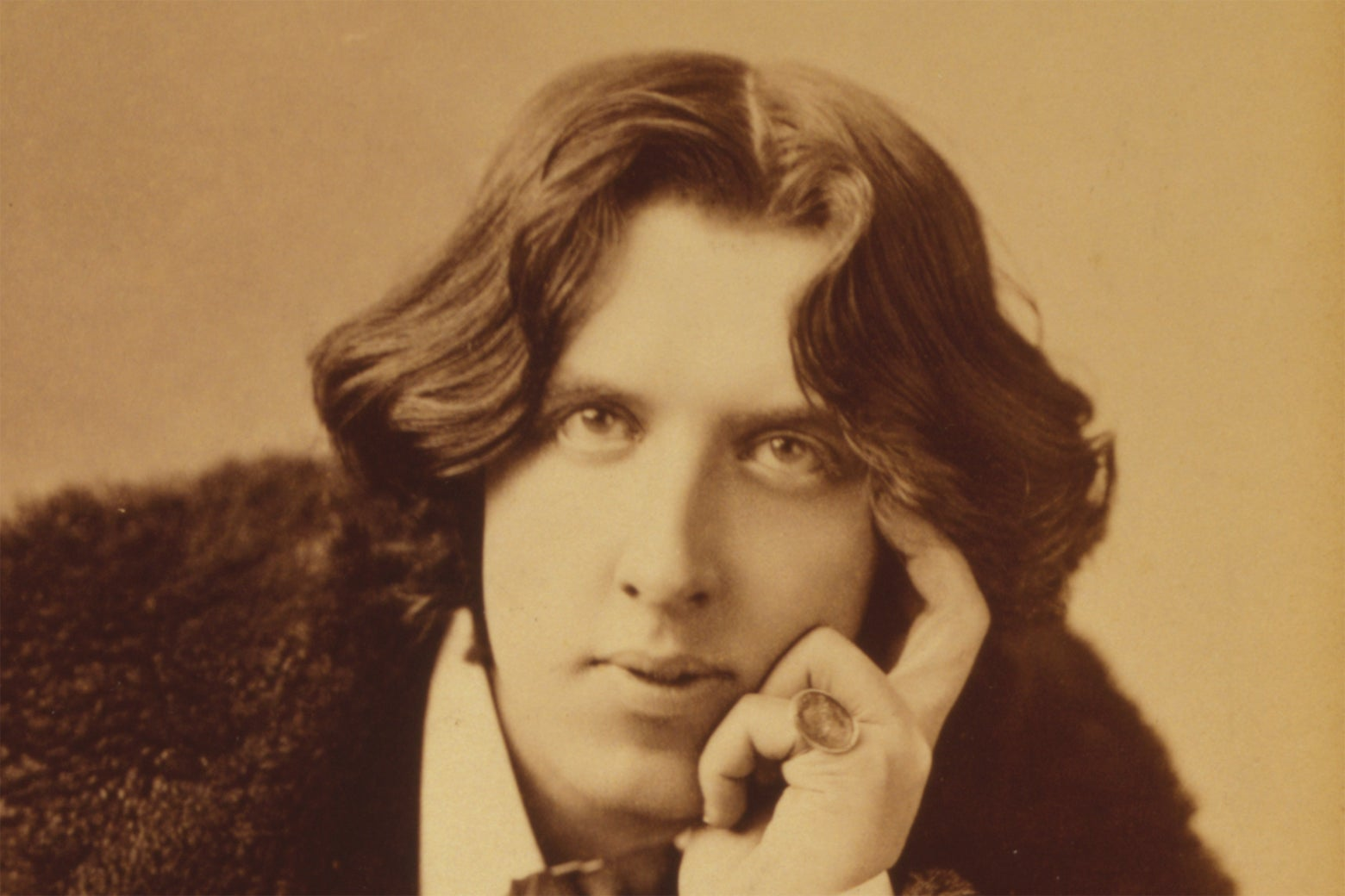 A portrait of Oscar Wilde.