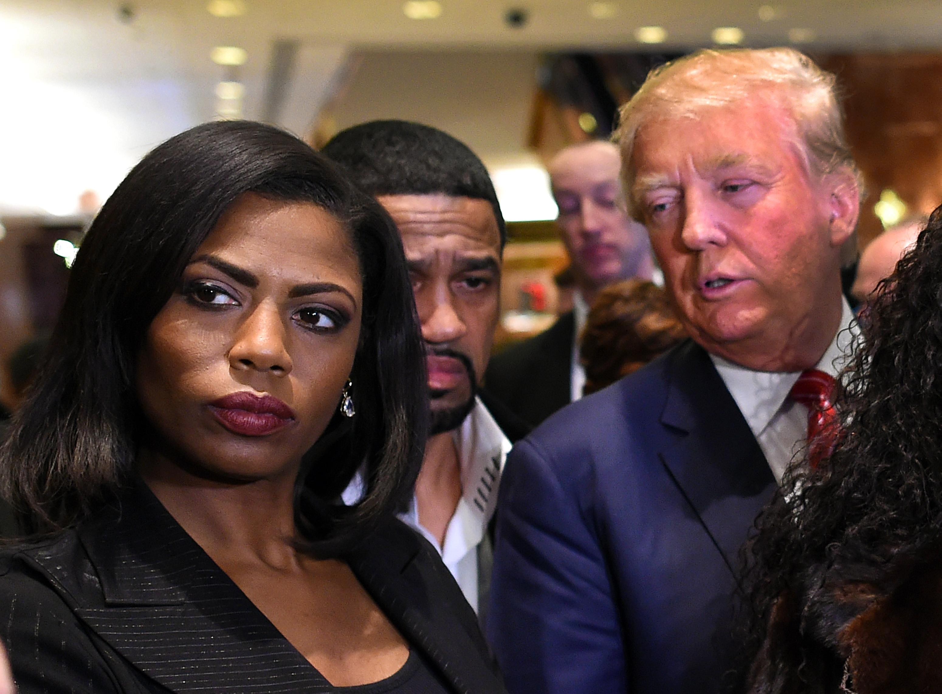 Omarosa Manigault and Donald Trump, among a crowd of people.