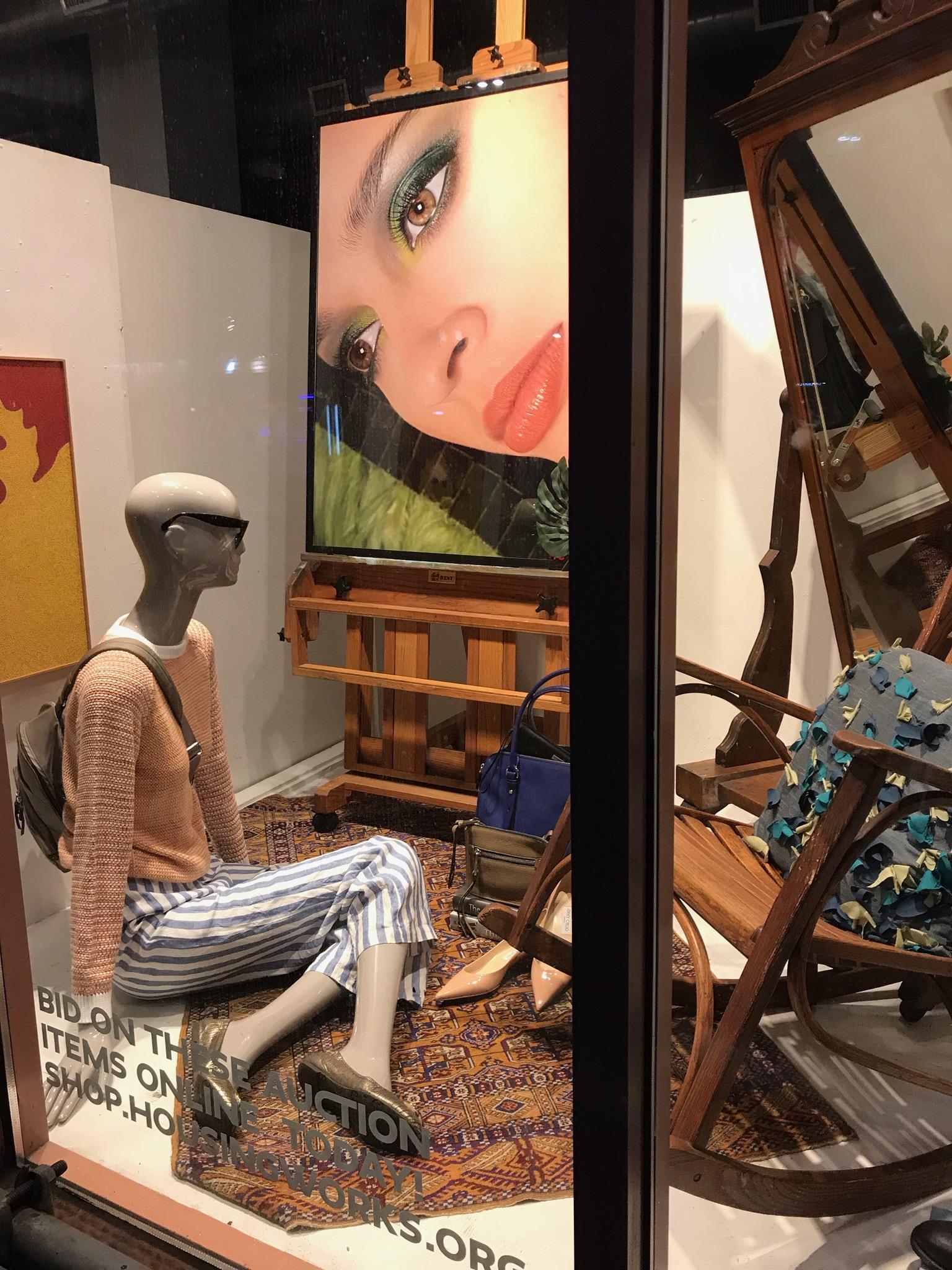 Photo of a scene in a store window. It is zany.