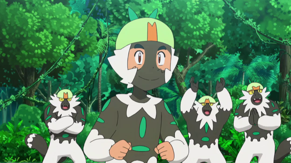 Ash Ketchum stands in front of three lemur-like Pokémon. He is dressed like the Pokémon and wears black facepaint resembling their markings.