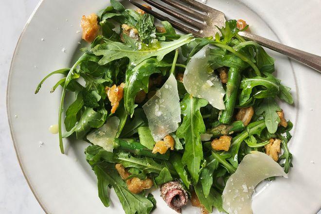 Arugula salad with beans, parmesan, and anchovies.