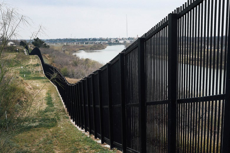 A border fence is seen near the Rio Grande.