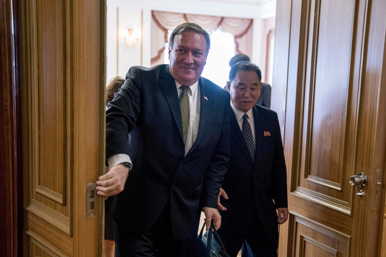 Secretary of State Mike Pompeo (L) and Kim Yong Chol, North Korean senior ruling party official and former intelligence chief, depart following two days of meetings at Park Hwa Guest House in Pyongyang on July 7, 2018.