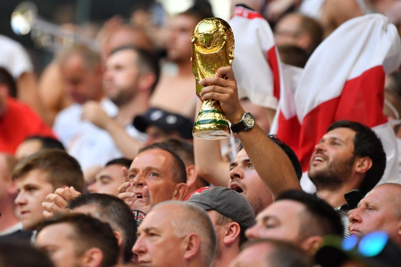 An England fan holds up a replica of the World Cup trophy during the Russia 2018 World Cup quarter-final football match between Sweden and England at the Samara Arena in Samara on July 7, 2018. (Photo by Yuri CORTEZ / AFP) / RESTRICTED TO EDITORIAL USE - NO MOBILE PUSH ALERTS/DOWNLOADS        (Photo credit should read YURI CORTEZ/AFP/Getty Images)