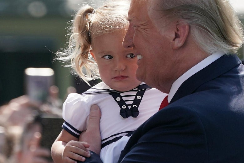 President Donald Trump holds a girl prior to his departure from the White House July 5, 2019 in Washington, D.C.