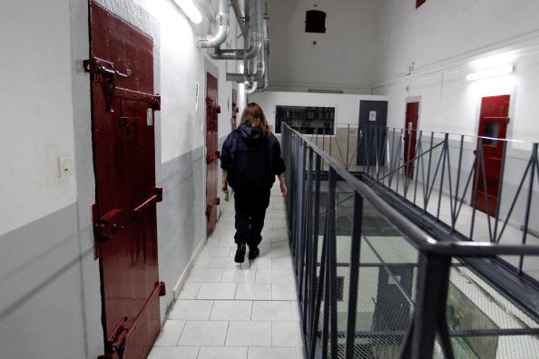 A prison guard walks through a corridor at the Ajaccio's jail on January 24, 2013, in Ajaccio, Corsica.