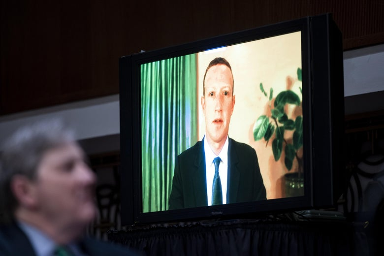 "WASHINGTON, DC - NOVEMBER 17: Mark Zuckerberg, Chief Executive Officer of Facebook, testifies remotely as Sen. John Kennedy, R-La., looks on during the Senate Judiciary Committee hearing on ""Breaking the News: Censorship, Suppression, and the 2020 Election"" on November 17, 2020 in Washington, DC. Facebook CEO Mark Zuckerberg and Twitter CEO Jack Dorsey are scheduled to testify remotely.(Photo By Bill Clark-Pool/Getty Images)"