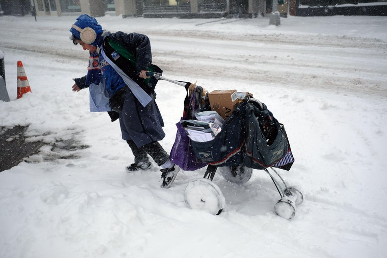 A postwoman drags her mail cart on a snow-covered street during a winter storm in New York on February 9, 2017.   A heavy winter snow storm lashed the northeastern United States Thursday, subjecting New York to near blizzard-like conditions and forcing flight cancellations as schools and the United Nations closed. / AFP PHOTO / Jewel SAMAD        (Photo credit should read JEWEL SAMAD/AFP/Getty Images)