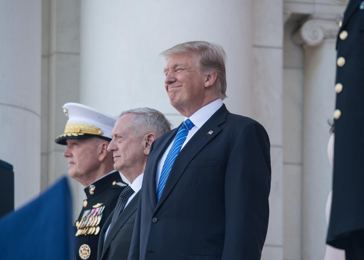 US President Donald Trump greets members of the US military
