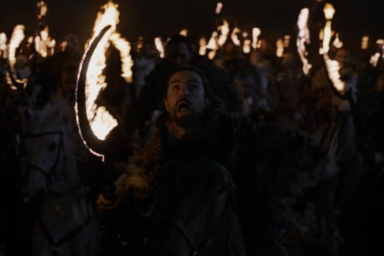 A Dothraki warrior, riding toward camera, looking up in horror at whatever he's riding toward.