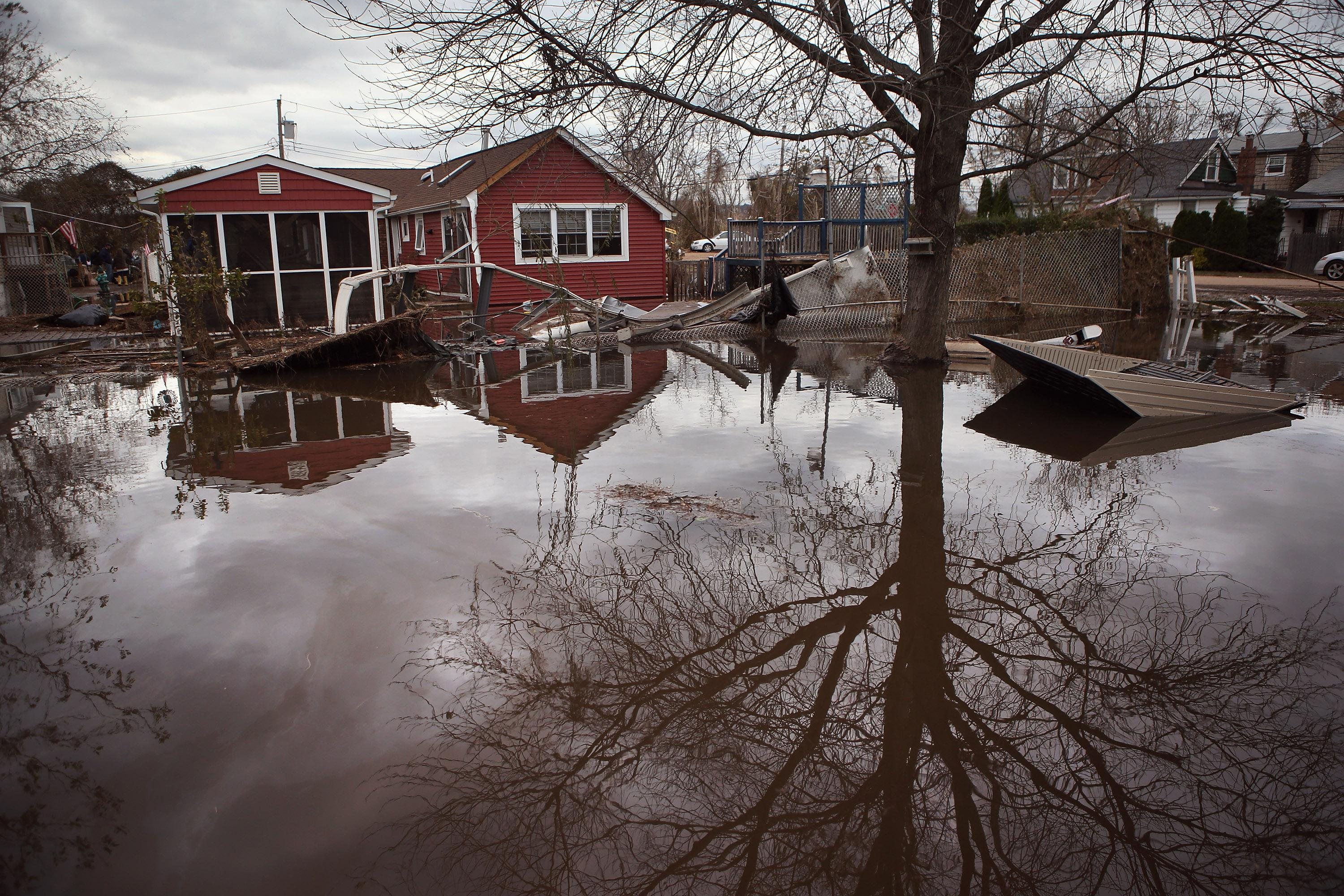 Water continues to flood a neighborhood on November 1, 2012 in the Ocean Breeze area of the Staten Island borough of New York City.