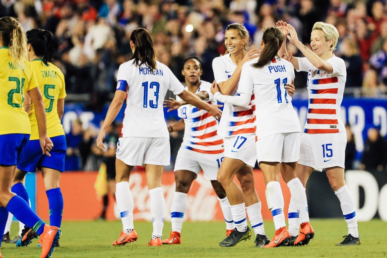 Soccer players Megan Rapinoe, Mallory Pugh, and Alex Morgan celebrate with Tobin Heath.