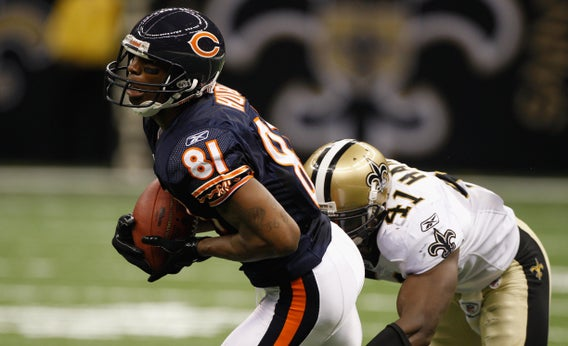 Sam Hurd of the Chicago Bears catches a pass over Roman Harper of the New Orleans Saints on September 18, 2011 in New Orleans, Louisiana.