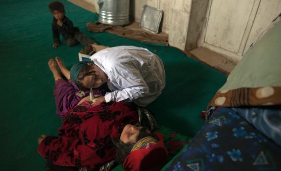 Afghani woman giving birth.
