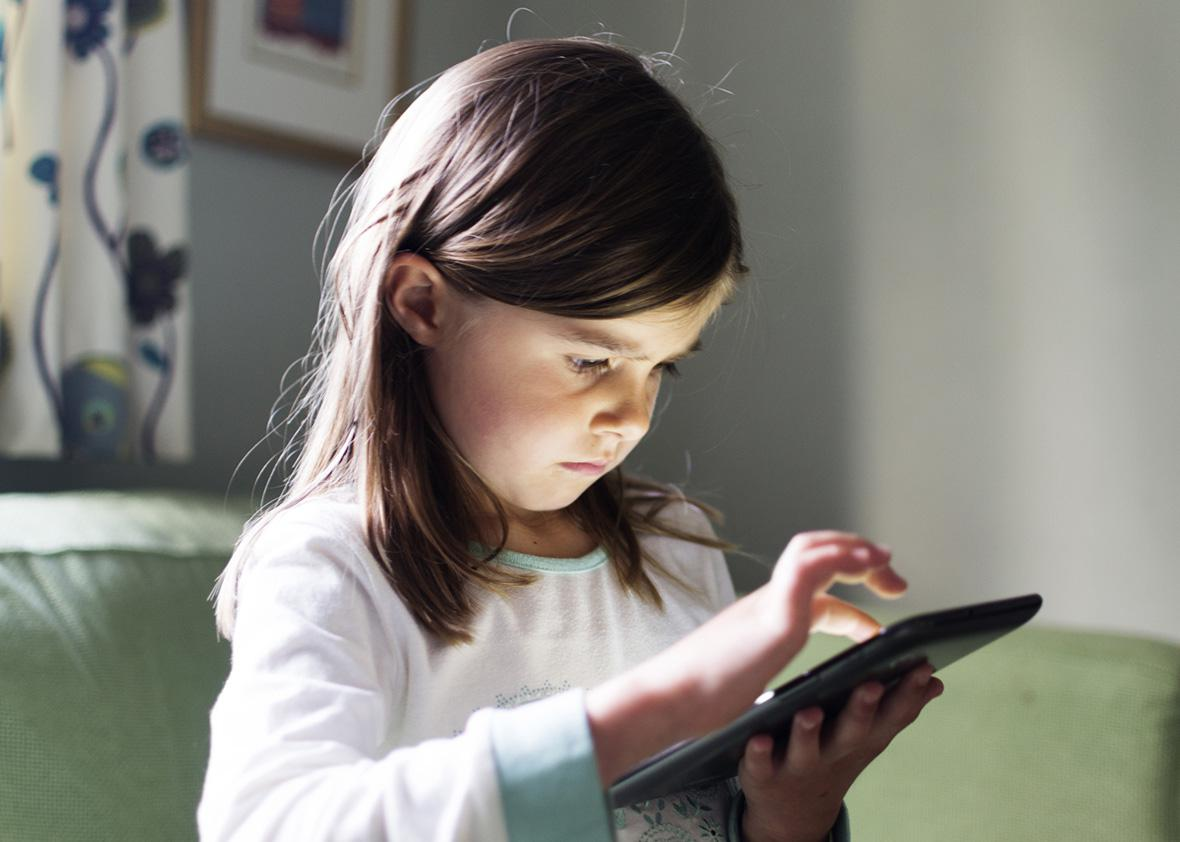 Child on tech toy