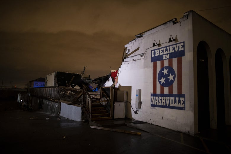 """The wreckage of the Basement East club. Much of the building collapsed, but a wall with a mural that reads """"I Believe in Nashville"""" remains standing."""