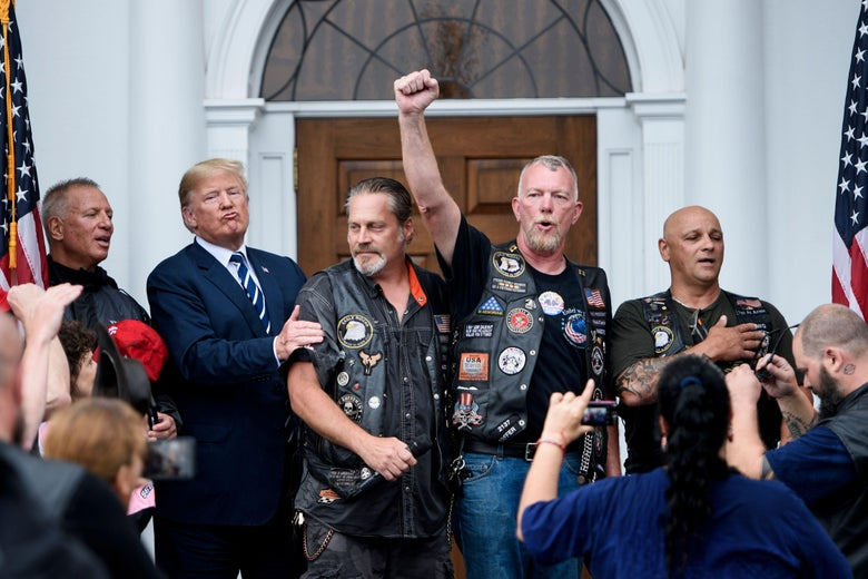 Trump posing for photos with a group of bikers