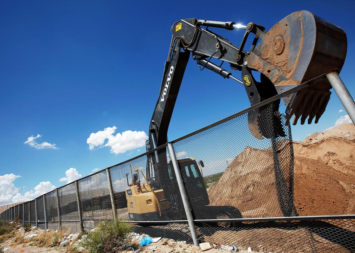 An excavator removes a fence, which will be replace by a section of the U.S.-Mexico border wall at Sunland Park, U.S. opposite the Mexican border city of Ciudad Juarez, Mexico, August 26, 2016.