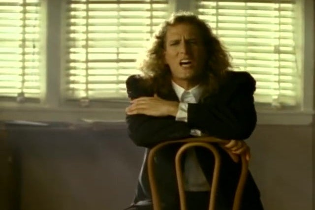 Michael Bolton, singing.