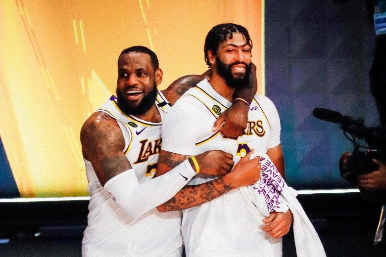LeBron James embraces Anthony Davis on the court, both smiling