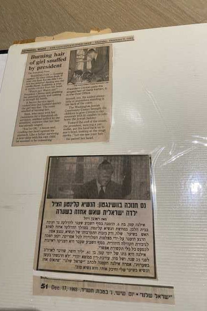 Page of a family album containing two newspaper article cutouts.