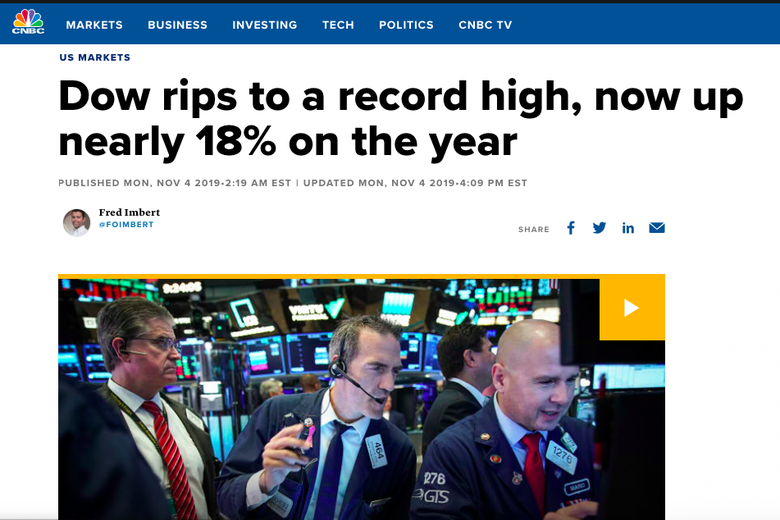 "Screenshot of a news story titled ""Dow rips to a record high, now up nearly 18% on the year."""