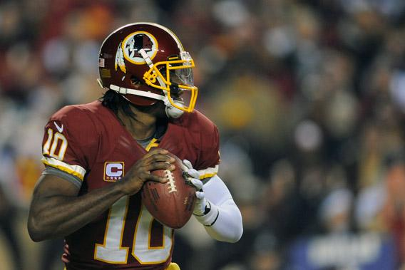 Robert Griffin III #10 of the Washington Redskins drops back to pass during their game against the Dallas Cowboys at FedExField on December 30, 2012 in Landover, Maryland.