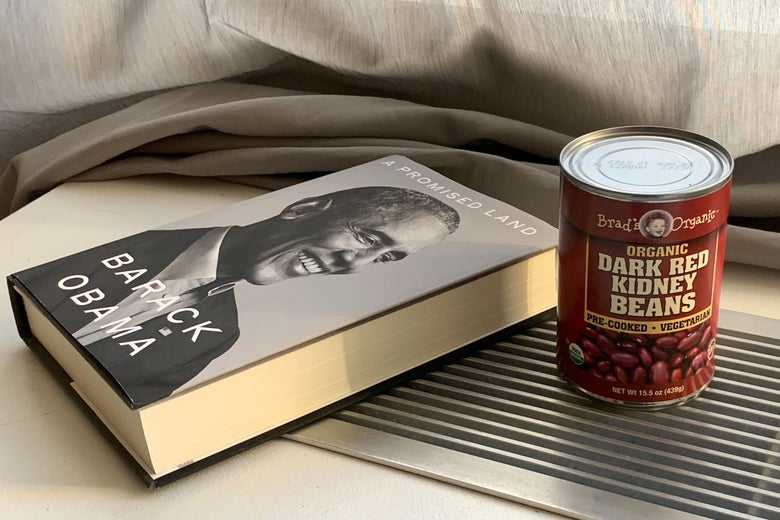 Against a gray curtain backdrop, Barack Obama's new book lies on its side in the sunlight, next to a can of red kidney beans.