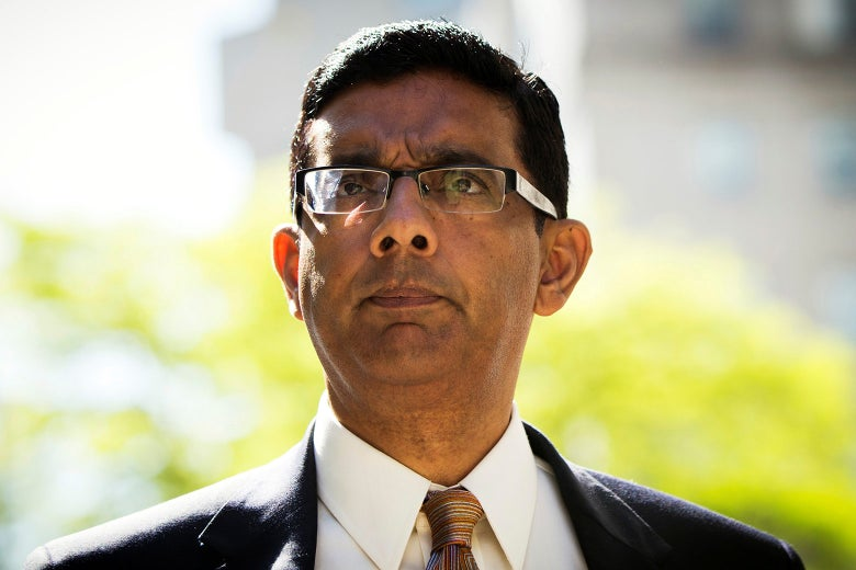 Conservative commentator and best-selling author Dinesh D'Souza exits the Manhattan Federal Courthouse after pleading guilty to campaign finance law violations in New York City on May 20, 2014.