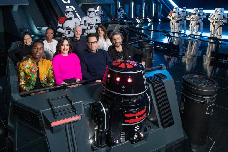 The cast of the upcoming film, Star Wars: The Rise of Skywalker, (L-R, front to back) John Boyega, Daisy Ridley, director J.J. Abrams, Oscar Isaac, Kelly Marie Tran, Naomi Ackie, Anthony Daniels and Keri Russell, gets a first-look at the new Star Wars: Rise of the Resistance attraction in Star Wars: Galaxys Edge at Disneyland Park December 2, 2019 in Anaheim, California.