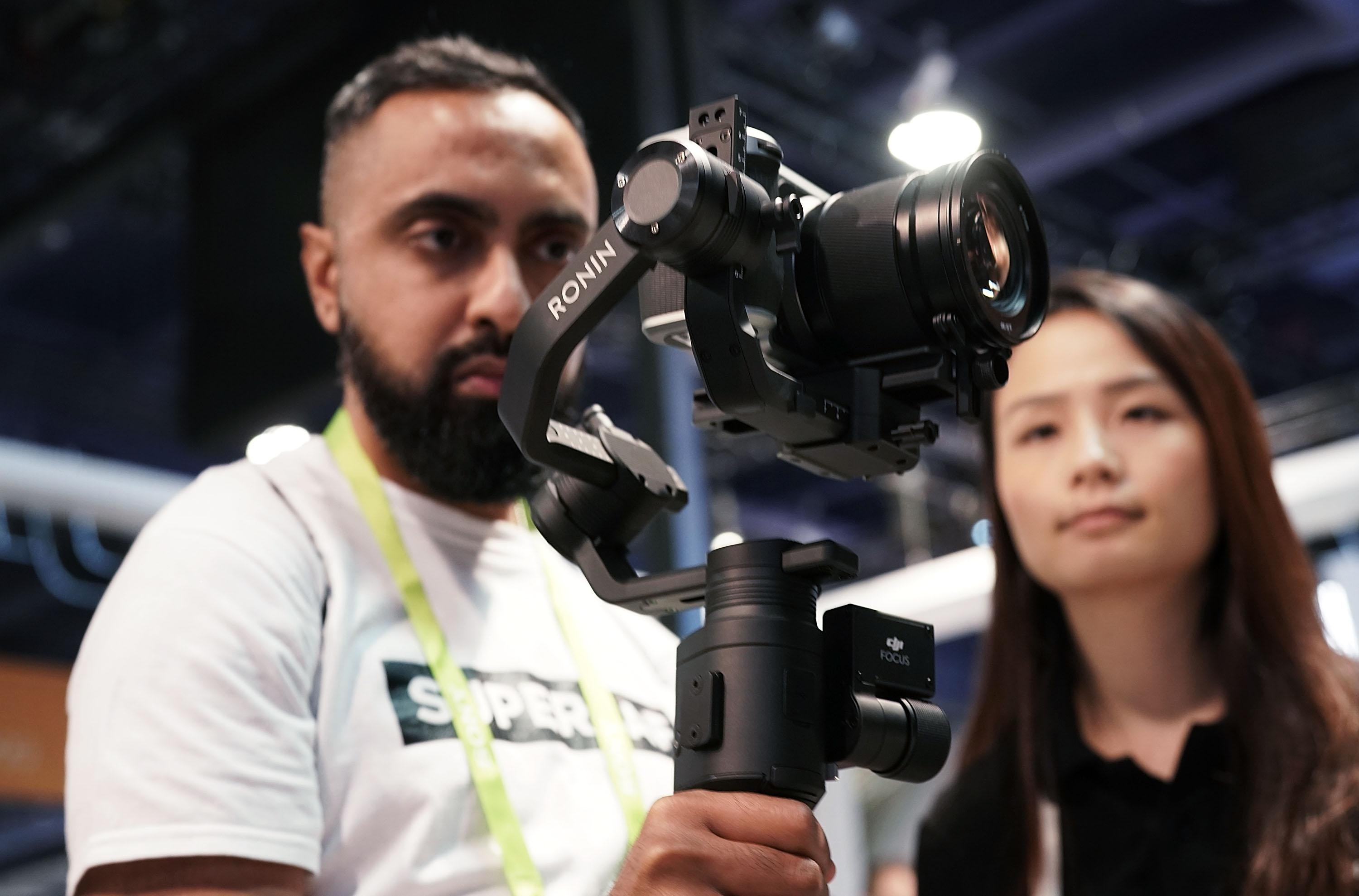 LAS VEGAS, NV - JANUARY 11:  An attendee tries the new DJI Ronin-S camera stabilizer for small DSLR during CES 2018 at the Las Vegas Convention Center on January 11, 2018 in Las Vegas, Nevada. CES, the world's largest annual consumer technology trade show, runs through January 12 and features about 3,900 exhibitors showing off their latest products and services to more than 170,000 attendees.  (Photo by Alex Wong/Getty Images)
