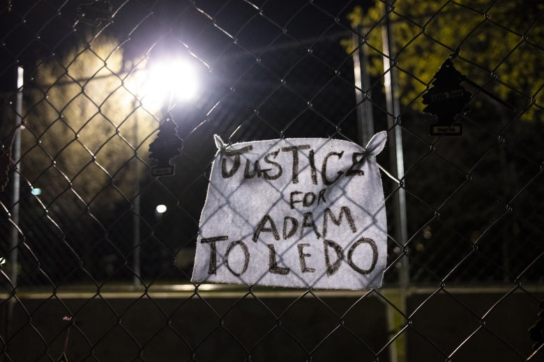 "Diagonal fencing with a sign that reads ""Justice for Adam Toledo."""