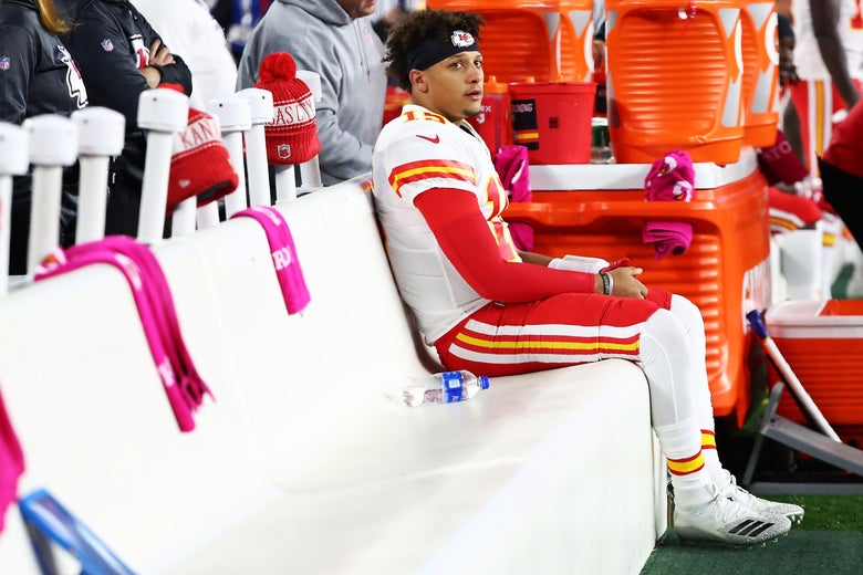 FOXBOROUGH, MA - OCTOBER 14:  Patrick Mahomes #15 of the Kansas City Chiefs looks on from the bench before a game against the New England Patriots at Gillette Stadium on October 14, 2018 in Foxborough, Massachusetts.  (Photo by Adam Glanzman/Getty Images)
