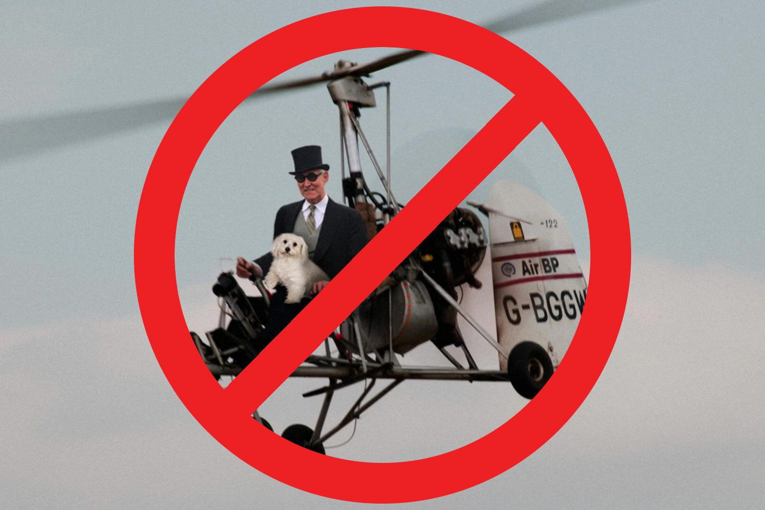 A photo of Roger Stone in an autogyro, with a big red circle and a slash through it superimposed.
