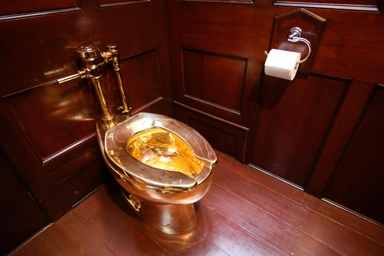 Solid gold toilet and a piece of art, America, created by the artist Maurizio Cattelan, at the exhibition in England in 2019.