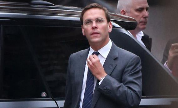 ormer News International chairman James Murdoch adjusts his tie as he arrives at the High Court.