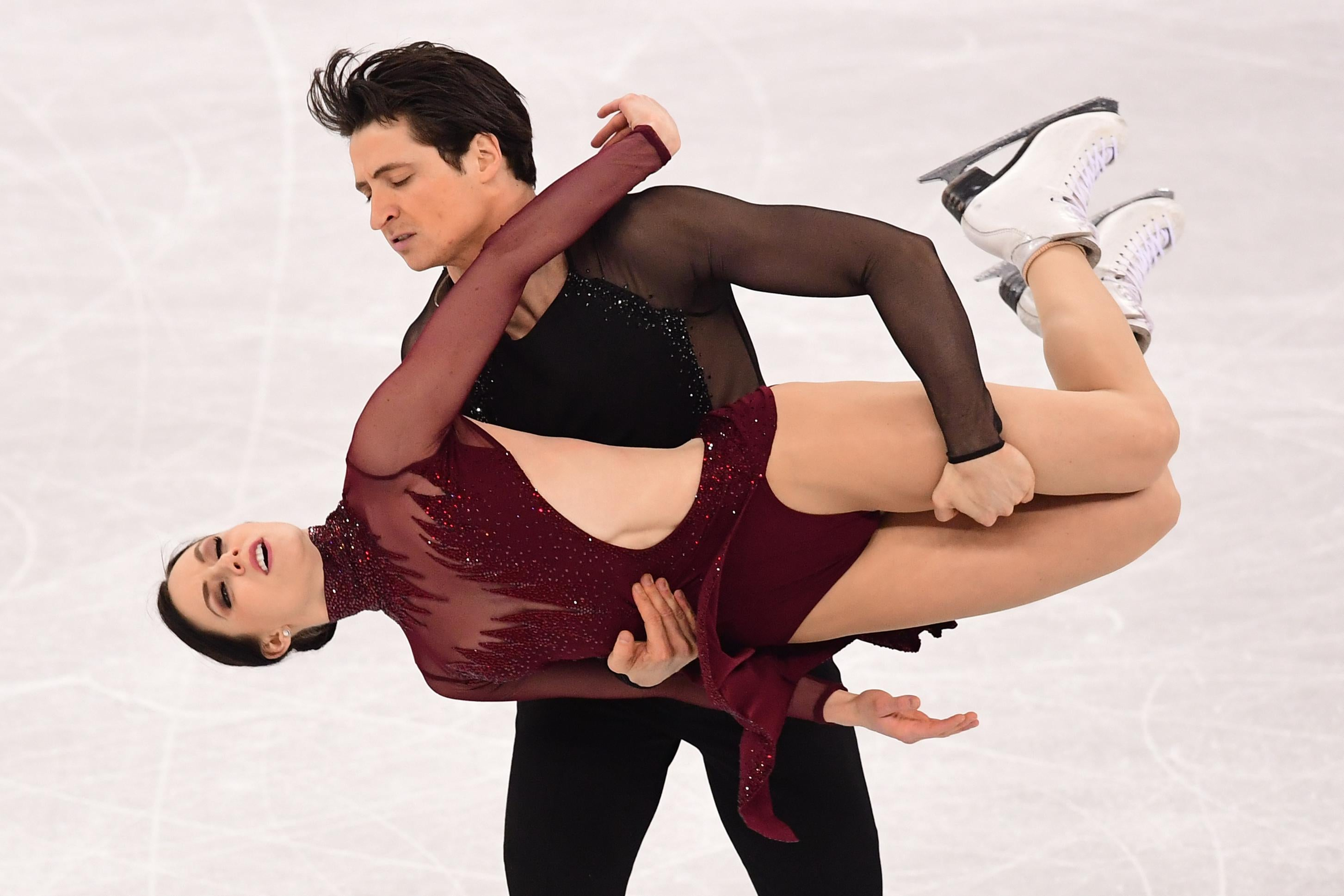 TOPSHOT - Canada's Tessa Virtue and Canada's Scott Moir compete in the ice dance free dance of the figure skating event during the Pyeongchang 2018 Winter Olympic Games at the Gangneung Ice Arena in Gangneung on February 20, 2018. / AFP PHOTO / Roberto SCHMIDT        (Photo credit should read ROBERTO SCHMIDT/AFP/Getty Images)