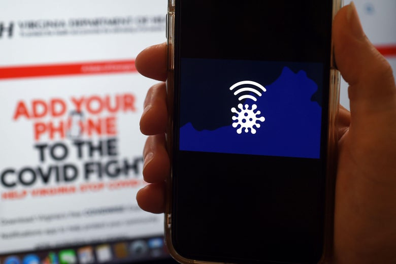 "A hand holds a smartphone displaying the Covidwise app logo, while in the background a screen reads ""Add your phone to the COVID fight."""