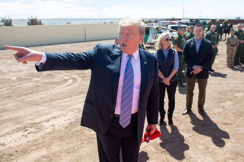 President Donald Trump tours the border wall between the United States and Mexico in Calexico, California on April 5, 2019.