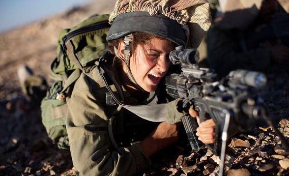 A female soldier from the 'Karakal' Battalion in action during training.