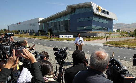 Mitt Romney poses for a Solyndra photo op in May.