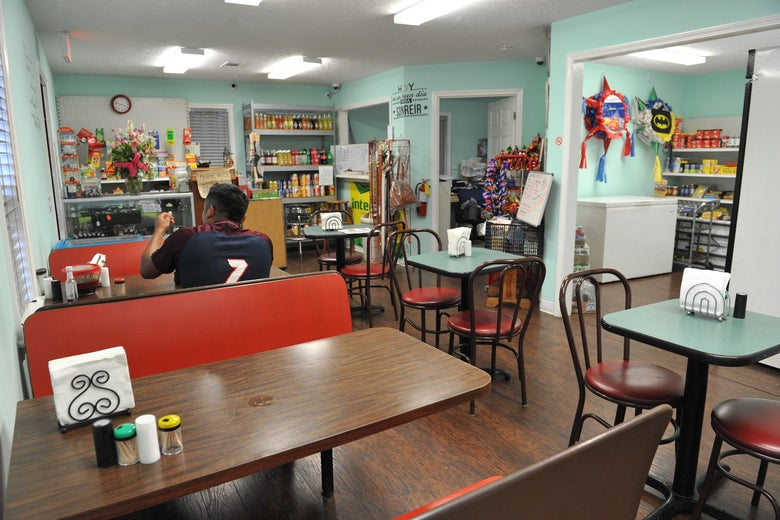 A lone customer sits in Maria's Mercado in Morton, Mississippi.