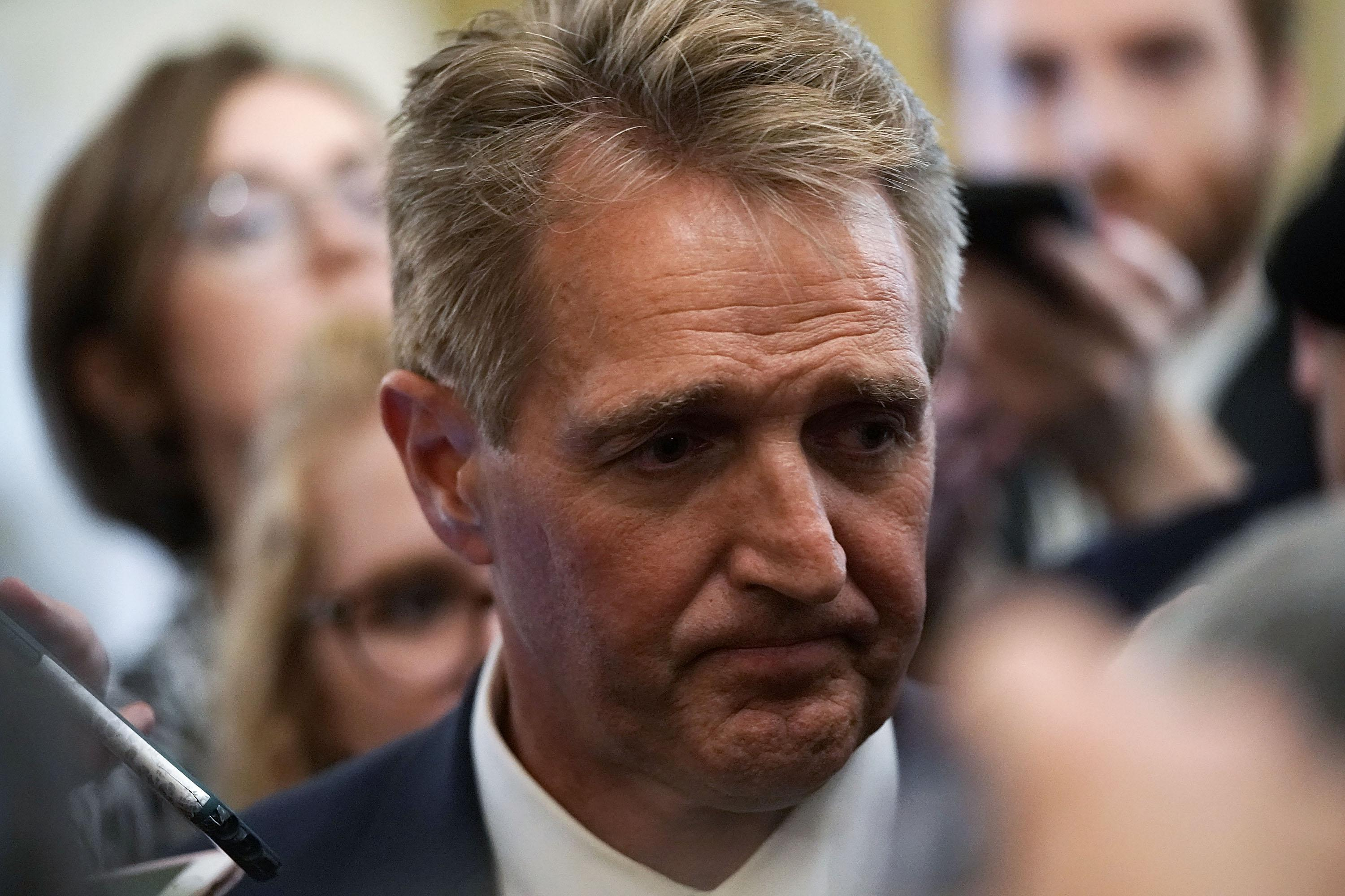 Republican Sen. Jeff Flake speaks to the press on September 28, 2018 at the U.S. Capitol in Washington, D.C.