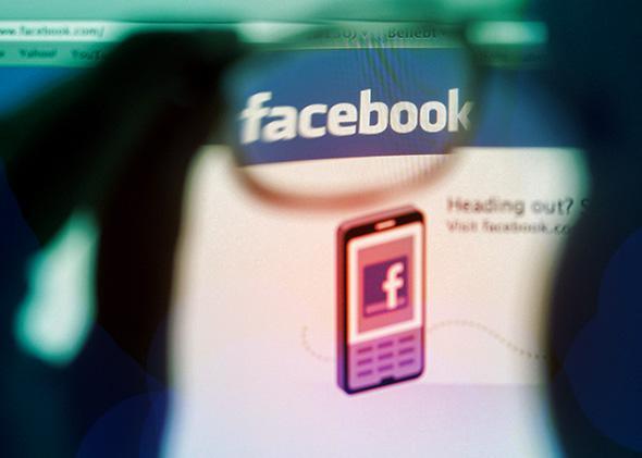 A Facebook logo on a computer.
