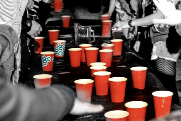 Men and women playing Flip Cup