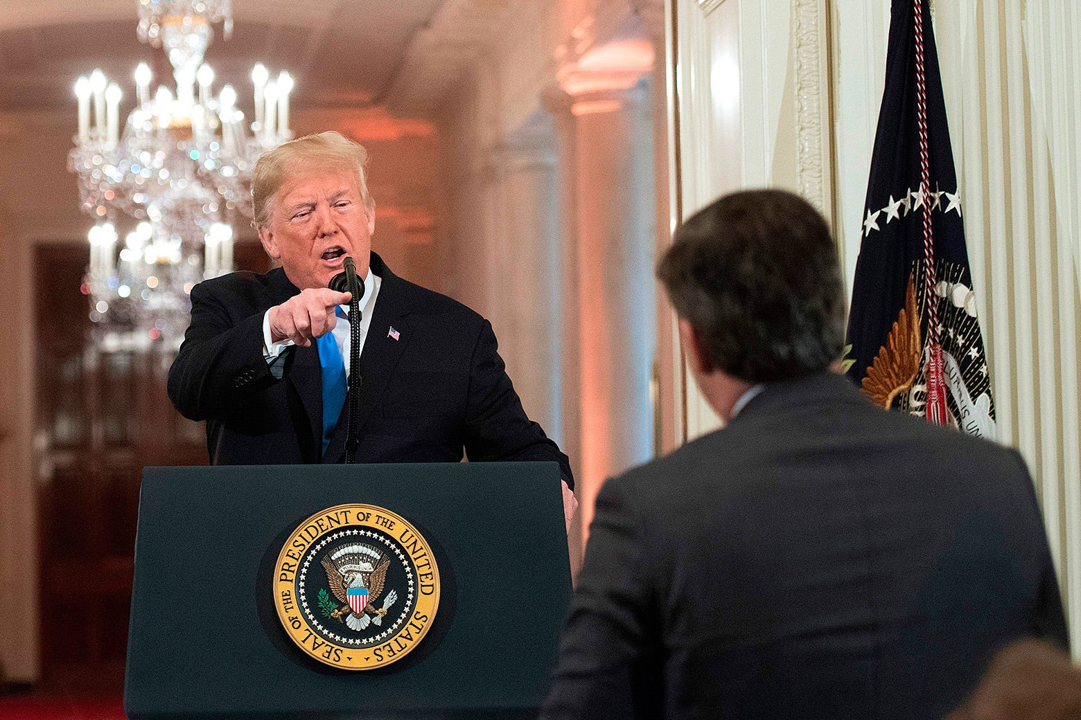 Donald Trump points angrily during a heated exchange with CNN chief White House correspondent Jim Acosta during a post-election press conference on Nov. 7.